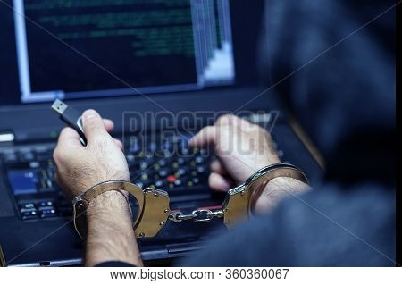Hands Of A Hacker In Handcuffs Holding Usb. Prisoner Or Arrested Terrorist In Handcuffs, Selective F