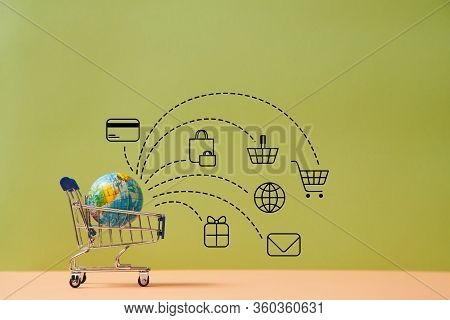Internet Shopping. Online Purchases. E-commerce. Worldwide Delivery, Transportation. Globe In Trolle