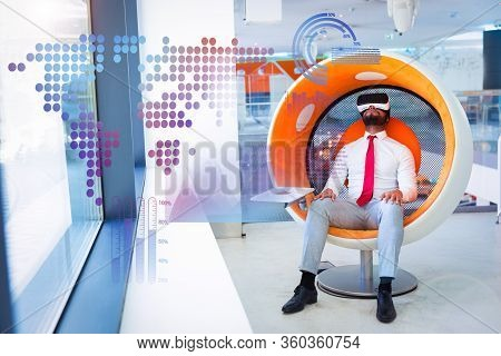 Relaxed Man Enjoying Vr Video And Virtual Statistic Graphics. Man In Office Clothes And Virtual Real