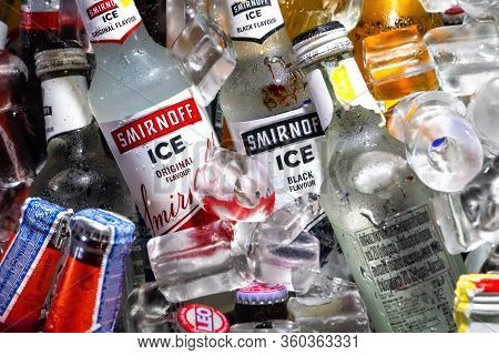 Close-up Of A Bottle Of Alcohol In A Box With Ice.  Smirnoff Vodka Is Cooled In Ice.  Thailand, Bang