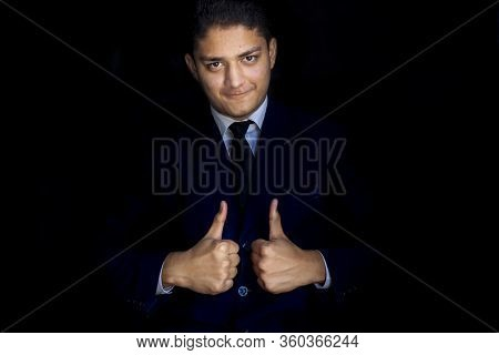 Happy And Positive Businessman Wishing Hope By Raising Thumbs Of Both The Hands And Gesture Of Hope/