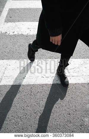 Road Safety Concept. A Pedestrian Crosses The Road On A Road Marking. Pedestrian And Driver