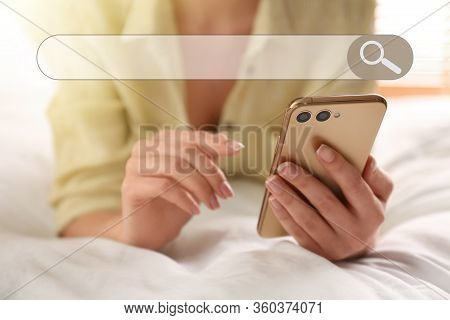 Search Bar Of Internet Browser And Woman Using Smartphone On Bed At Home, Closeup