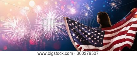 Free Happy Woman Enjoying Independence Day July 4th, USA. American Girl with National Flag