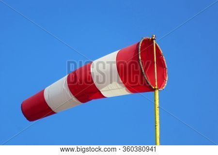Windsock Indicator Of Wind On Runway Airport.  Wind Cone Indicating Wind Direction And Force. Horizo