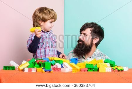 Building Home With Constructor. Child Development. Happy Family. Leisure Time. Father And Son Play G