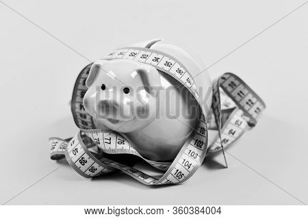 Piggy Bank And Measuring Tape. Budget Limit Concept. Credit Loan Debt. Financial Consulting. Economi