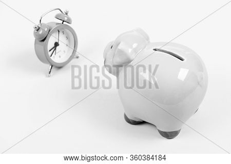 Credit Debt. It Is Time To Pay. Piggy Bank Pink Pig And Little Alarm Clock. Financial Crisis. Econom