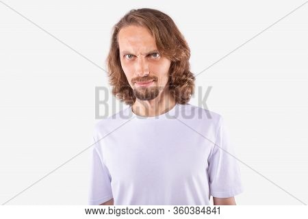 Caucasian Man With Long Curly Fair Hair And Blue Eyes In Casual White T-shirt Incredulously Looking
