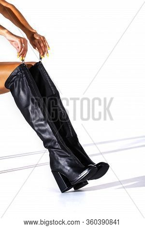 Black Hessian Boots On The Feet Of A Model On A White Background With Shadows. Jackboots. Studio Sho