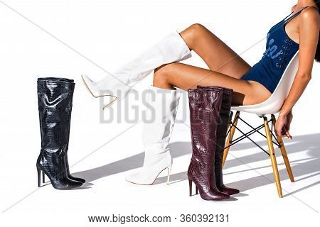 White Hessian Boots On The Feet Of A Model On A White Background With Shadows. Jackboots. Studio Sho