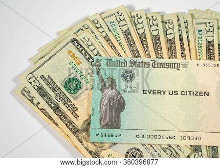 Stack Of 20 Dollar Bills With Us Treasure Illustrative Check To Illustrate Coronavirus Stimulus Paym