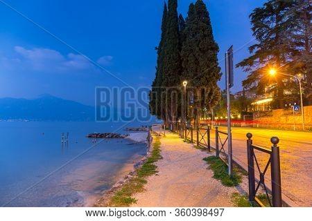 Beautful coastline of Garda lake at dusk, northern Italy