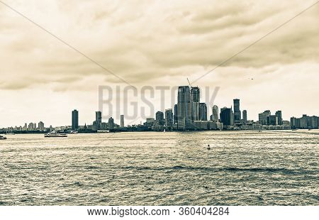 Dramatic Jersey City Panorama During The Gloomy Weather From The Staten Island Ferry In New York.