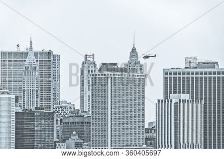Manhattan Island Buildings Tops During The Gloomy Weather From The Staten Island Ferry In New York.