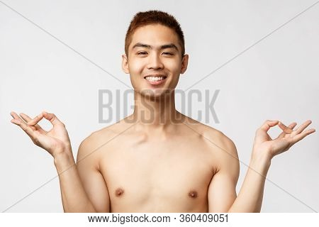 Beauty, People And Home Concept. Peaceful And Relaxed Happy Asian Man Standing Naked Over White Back