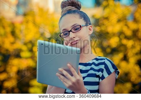 People, Children, Technology  Concept - Happy Girl Holding Tablet Pc Computers Contemplating Image O