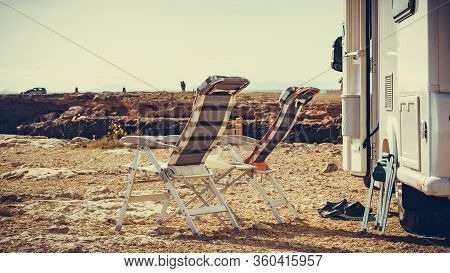 Camper, Recreational Vehicle And Chairs On Mediterranean Rocky Coast In Spain. Camping On Seaside. H