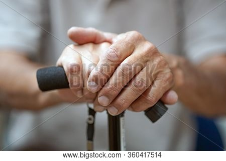 Hand Of A Old Man Holding A Cane. Senior Man Holding Cane. Close-up Of Old Man Hands On Walking Stic