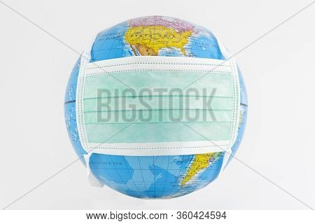Earth Globe With Mask On White Background