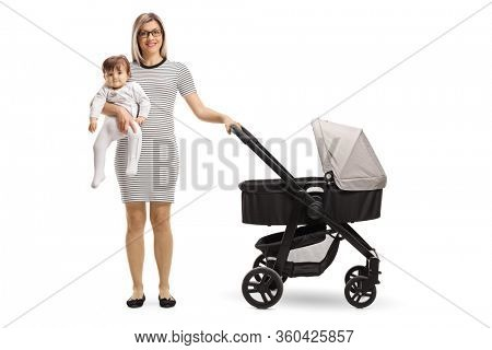 Mother with a pushchair holding a baby isolated on white background