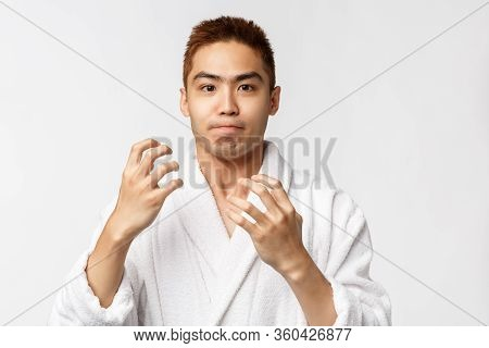 Beauty, Spa And Leisure Concept. Portrait Of Bothered, Fed Up Asian Man In Bathrobe, Raising Hands I