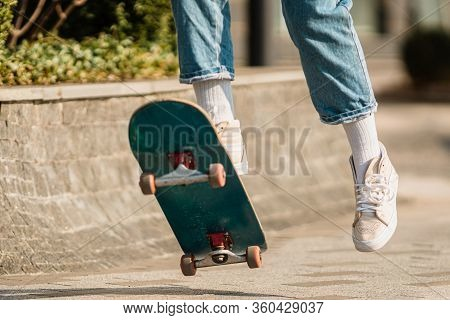 Skateboarding At City. Female, Enjoyment. Hipster Girl Riding Skate Board. Ride, Style. Extreme Spor