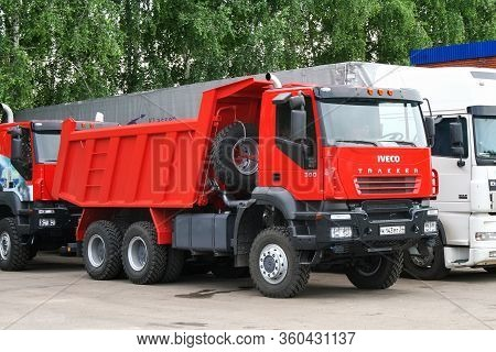 Tatarstan, Russia - June 14, 2008: Red Dump Truck Iveco Amt 6539 Trakker At The Countryside.