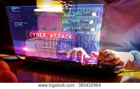 Hacker Typing On The Keyboard And Breaks Computer Security On Virtual Hologram Screen On Desk. Cyber
