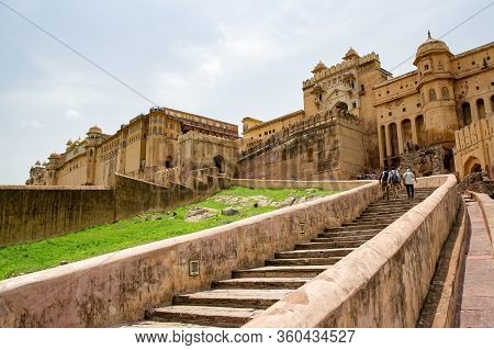 Jaipur, India - July 18, 2013: A Staircase To Amber Fort In Jaipur, India With Tourists Going Upstai
