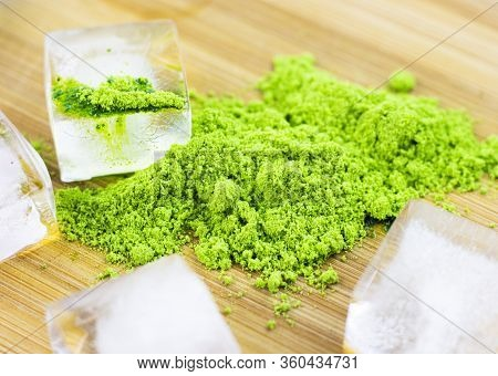 Different Colors Of Japanese Matcha Tea: Green, Red And Blue With Ice Pieces On A Wooden Stand. Powd