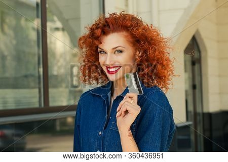 Cheerful Toothy Smile Woman Holding Showing Credit Card Near Bank Store Shopping Mall Outdoors In St