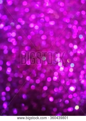 Glittering defocused festive light background