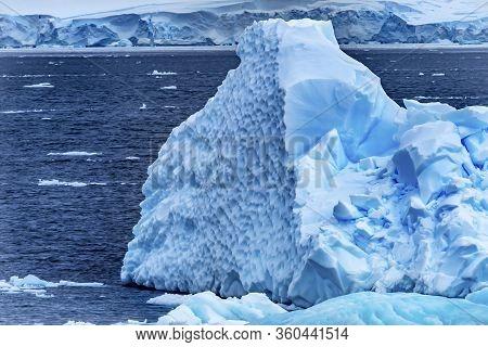 Iceberg Snow Mountains Blue Glaciers Iceberg Dorian Bay Antarctic Peninsula Antarctica.  Glacier Ice