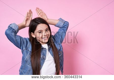 Graceful Young Funny Emotional Caucasian Girl Child Long-haired Brunette. Laugh And Smile And Holds