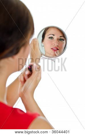 Portrait Of Attractive Woman With Lipstick Looking At The Mirrow. Isolated On White
