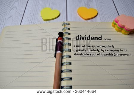 Definition Of Dividend Word With A Meaning On A Book. Dictionary Concept