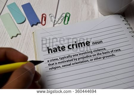 Definition Of Hate Crime Word With A Meaning On A Book. Dictionary Concept