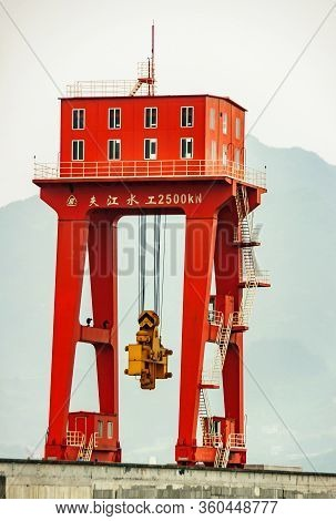 Three Gorges Dam, China - May 6, 2010: Yangtze River. Closeup Of Red Crane With Yellow Plug To Open