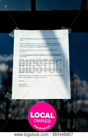 N. Vancouver, Canada - Apr 7, 2020: Covid-19 Closure Notice On Fron Door Of Tobys Northshore Restaur