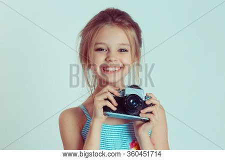 Beautiful Smiling Happy Child (kid, Girl) Holding Taking Pictures Looking At You Camera Gesture