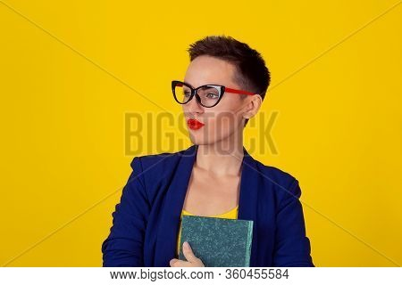 Beautiful Business Woman Short Hair Style Girl With A Book Isolated Yellow Background Copy Space. Bl