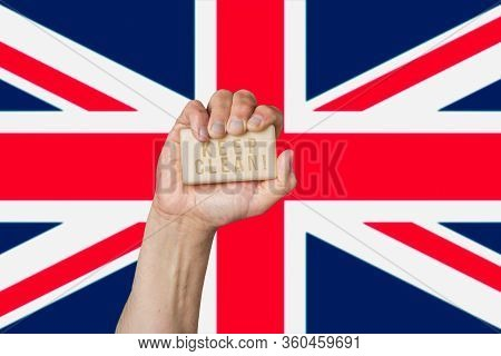 Caucasian Male Hand Holding Soap With Phrase: Keep Clean, Against British Flag Background