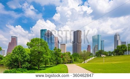 Houston, Texas, USA downtown city skyline and park in the afternoon.