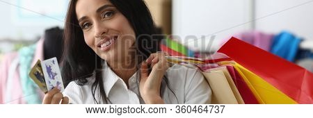 Portrait Of Beautiful Lady Making Purchases Of Expensive Things In Showroom. Wonderful Businesslady