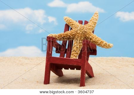 Starfish in an Adirondack chair sitting in the sand on the beach summer vacation poster