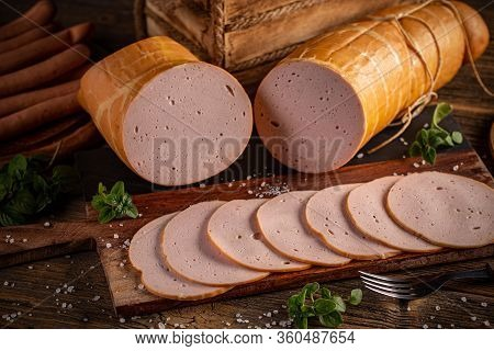 Slices Of Deli Meat On Vintage Wooden Cutting Board