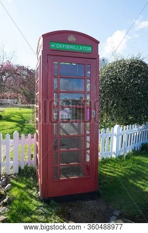 Appledore, Kent, United Kingdom - March 6, 2020: Iconic Red Phone Box Repurposed To House A Defibril