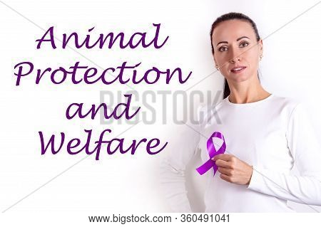 Inscription Animal Protection And Welfare On A White Background And A Girl With A Symbolic Purple Ri