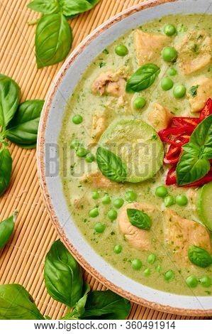 Thai Green Curry With Chicken Or Gaeng Kaew Wan Gai In White Bowl. Thai Green Curry Is A Thailand Cu